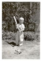 Dave Baldwin trying to swing a bat at age of two.